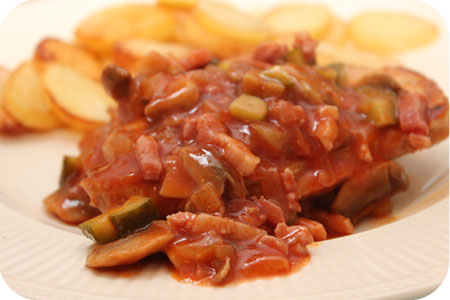 Karbonade met Champigons in Tomaten en Wijnsaus